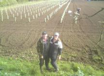 Andrew and Ronnie in the vineyard with the staff busy behind planting the first vines.