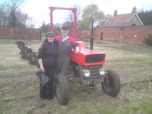 Tom and Ronnie just beginning to plough the first furrow in the wallled garden.